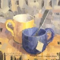 "Still Life with Yellow Mug, Blue Mug, Spoon, & Tea Bag Tag. Oil on Canvas. 10"" x 10""."